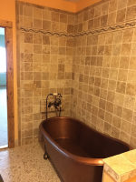 Copper bathtub and tile work in new bathroom